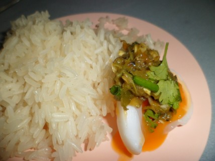 Sticky rice, boiled egg with Nam Prik Num, love the taste of it.