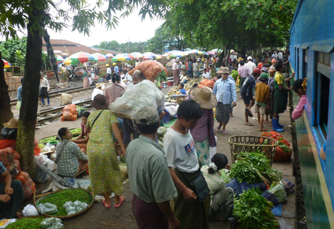 Some market next to the tracks.
